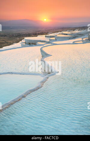 Pamukkale, sunset at the limestone terraces, Turkey - Stock Photo