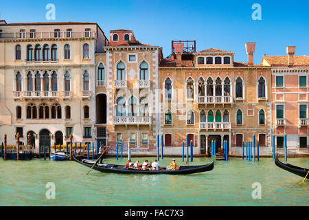 Venice, Italy - tourists in gondola on Grand Canal - Stock Photo