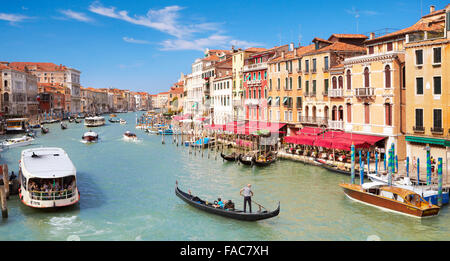 Waterbus and gondola on the Grand Canal, Venice, Veneto, Italy - Stock Photo