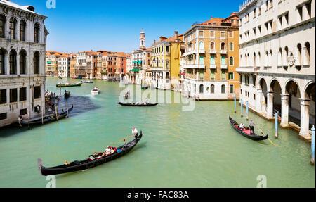 Venice view from the Rialto Bridge - gondola on the Grand Canal, Venice, Italy, UNESCO - Stock Photo