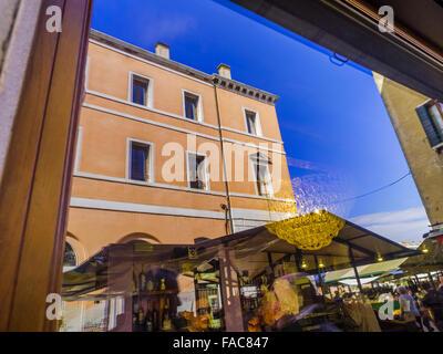 Shop window relections of Mercato di Rialto in Venice, Italy - Stock Photo
