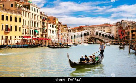Gondola on the Grand Canal at Rialto Bridge in Venice, Italy, UNESCO - Stock Photo