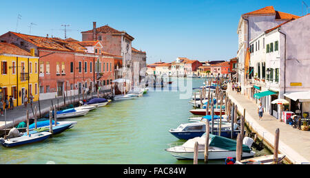 Canal of Fondamente dei Vetrai with boats moored on quay and bridge over canal, Murano Lagoon Island, Veneto, UNESCO - Stock Photo