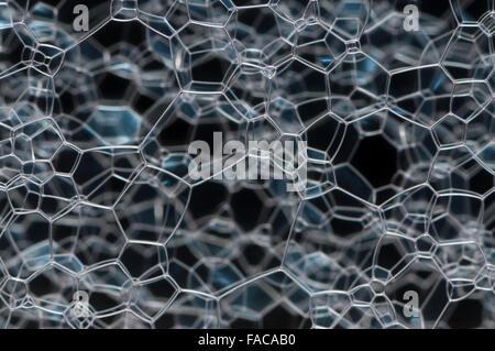Beautiful white glass lattice, over a dark background - Stock Photo