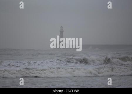 Roker Lighthouse on an overcast winter day in Sunderland, England. - Stock Photo