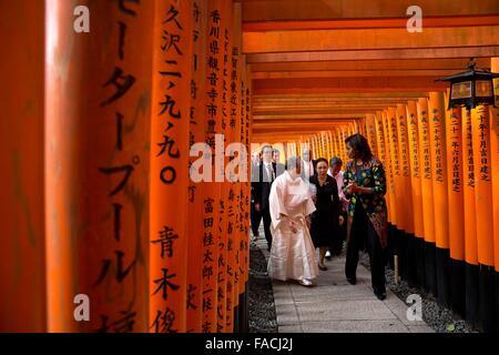 First Lady Michelle Obama walks through the torii gates during a tour of the Fushimi Inari Shinto Shrine March 20, - Stock Photo