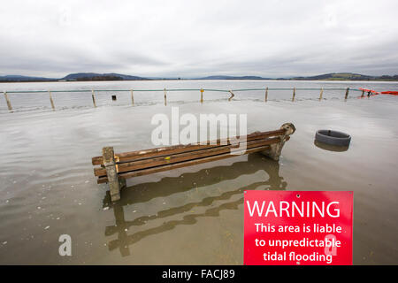 Flood waters on the road at Storth on the Kent Estuary in Cumbria, UK, during the January 2014 storm surge and high - Stock Photo