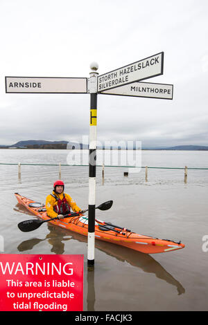 Kayakers in the flood waters on the road at Storth on the Kent Estuary in Cumbria, UK, during the January 2014 storm - Stock Photo