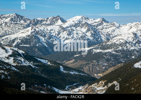 Snowy Pyrenees peaks rising above Soldeu ski area, Andorra - Stock Photo