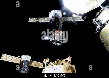 The Russian Soyuz TMA-17M spacecraft uncouples from the dock at the International Space Station to return to Earth - Stock Photo