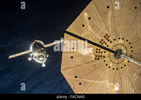The Russian Soyuz TMA-19M spacecraft approaches for a manual docking to the Rassvet module at the International - Stock Photo