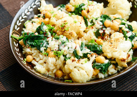 Roasted Cauliflower Risotto with Spinach and Chickpeas - Stock Photo