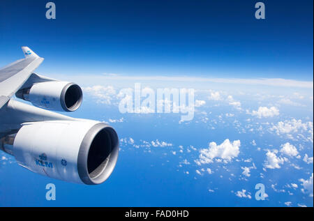An Airplane Wing an engines During a Flight - Stock Photo