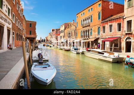 Canal of Fondamente dei Vetrai with moored boats, Murano Lagoon Island, Veneto, Venice, UNESCO - Stock Photo