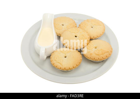 ... Holly decorated mince pies on a plate with a jug of cream isolated against white -  sc 1 st  Alamy & Mince pies with cream on a plate isolated against white Stock Photo ...