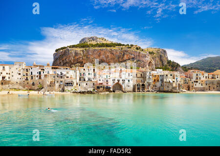 Medieval houses and La Rocca Hill, Cefalu, Sicily, Italy - Stock Photo