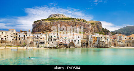 Medieval houses and La Rocca hill, panoramic view, Cefalu old town,  Sicily, Italy - Stock Photo