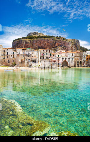 Medieval houses and La Rocca hill, Cefalu old town, Sicily, Italy - Stock Photo