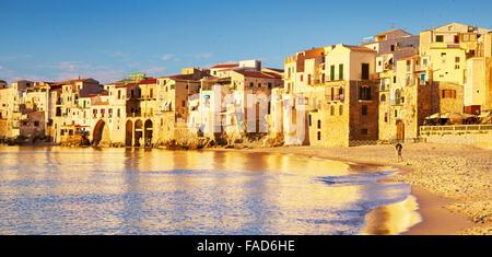 Cefalu medieval houses on the seashore, Sicily Island, Italy - Stock Photo