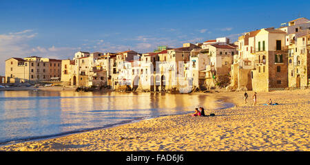 Sicily Island - Medieval houses on the seashore, Cefalu Old Town, Italy - Stock Photo