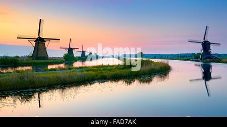 Kinderdijk windmills before sunrise - Holland Netherlands - Stock Photo