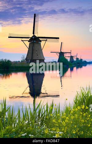Netherlands windmills at dusk - Kinderdijk, Holland - Stock Photo