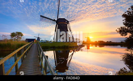 Kinderdijk windmills at sunset - Holland Netherlands - Stock Photo