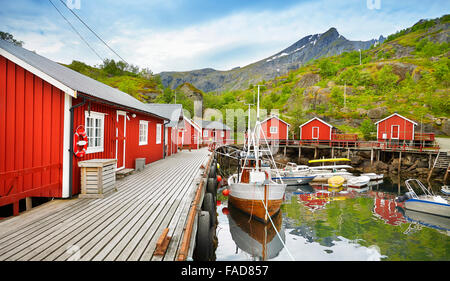 Lofoten Islands, red fishermen's huts rorbu, Nusfjord, Norway - Stock Photo