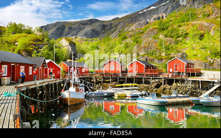 Lofoten Islands, harbor with red fishermen's huts, Nusfjord, Norway - Stock Photo