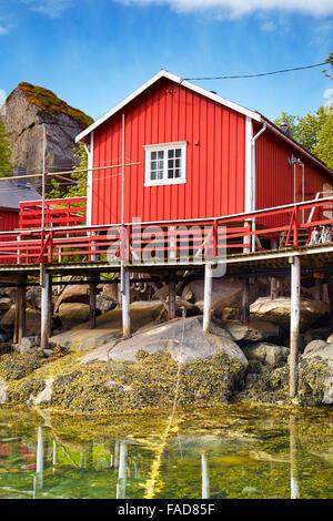 Traditional red fishermen's hut rorbu, Flakstadoy Island, Lofoten, Norway - Stock Photo