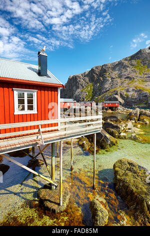 Traditional red wooden fishermen's huts rorbu, Lofoten Island, Norway - Stock Photo