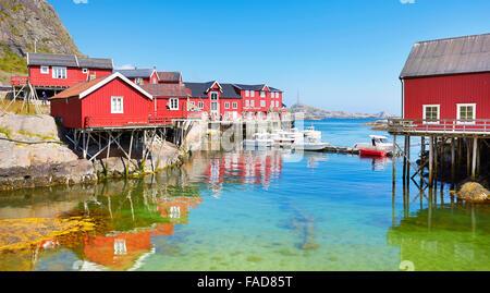 Traditional red wooden rorbu houses on Moskenesoya Island, Lofoten Islands, Norway - Stock Photo