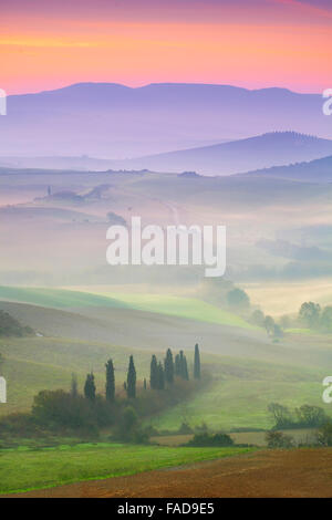 Val d'Orcia at dawn, Tuscany, Italy - Stock Photo
