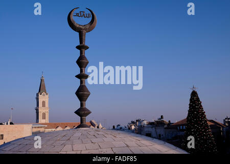 Muslim crescent moon and a church tower, Old City of ...