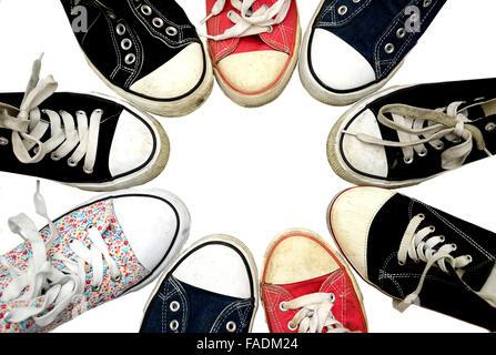 Worn Chucks, sneakers arranged in a circle - Stock Photo