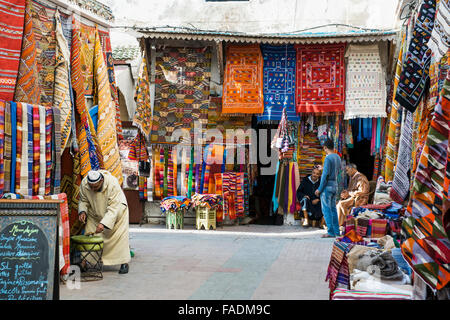 Carpet dealer in the historic centre, Essaouira, Morocco - Stock Photo