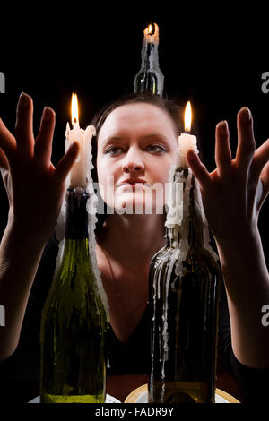 She read the black background with candle - Stock Photo