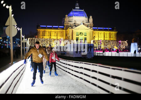 People skating in the city ice skating rink at Advent time in King Tomislav Park in Zagreb, Croat - Stock Photo
