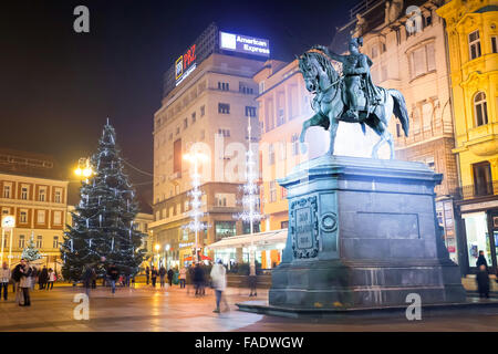 Advent time at night on central Jelacic Square with the Statue of Ban Josip Jelacic  in Zagreb, Croatia - Stock Photo