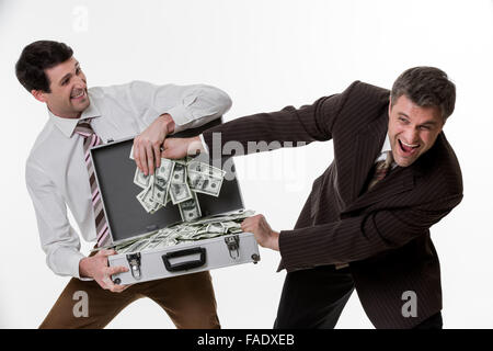 Businessmen divide profit. Clerks won the jackpot. Business people with suitcase full of money. - Stock Photo