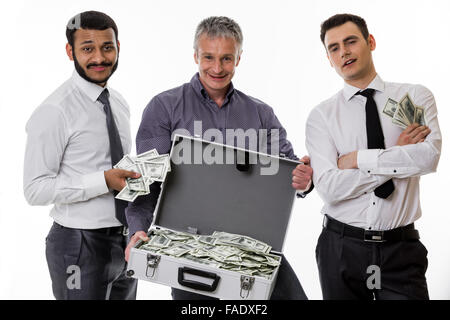 Young people with a suitcase full of money. Businessmen have earned a lot of money. - Stock Photo