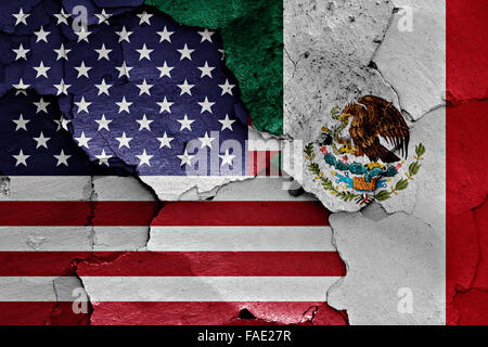 flags of USA and Mexico painted on cracked wall - Stock Photo