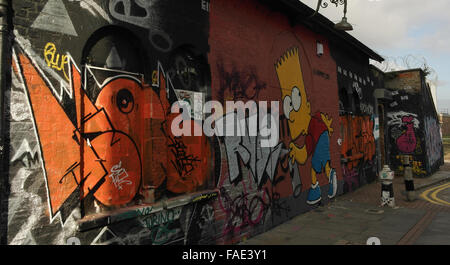 Grey clouds oblique view, looking east, red scrawl by Graffiti Life image Bart Simpson on Pedley Street wall, Brick - Stock Photo