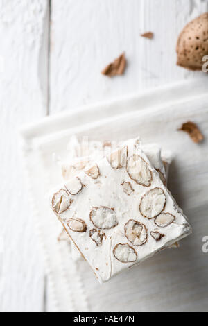 Slices of White Nougat with Almonds, a Traditional Italian Christmas Sweet - Stock Photo