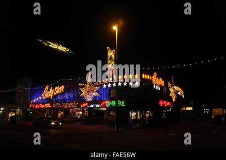 Night view across the Central Promenade towards the illuminated Lucky Star Amusement Arcade, Blackpool Illuminations, - Stock Photo