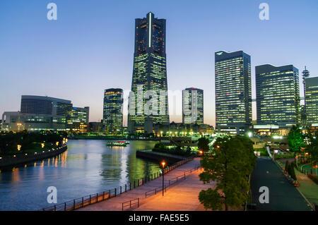 Skyline of the main business district of Yokohama, Minato Mirai 21, at dusk. - Stock Photo