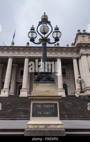Old-fashioned lantern and sign 'Parliament of Victoria' in front of the parliament house, Melbourne, Australia. - Stock Photo