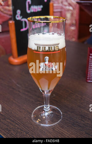 A glass of Julius beer, a Belgian strong pale ale brewed by the Hoegaarden brewery. - Stock Photo
