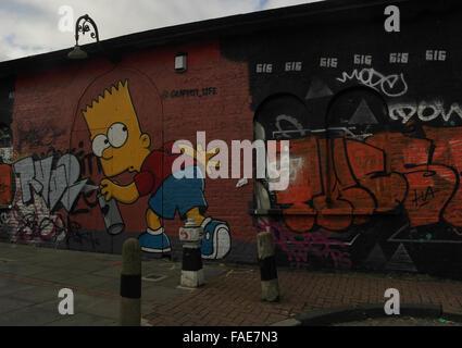 Oblique view Graffiti Life image of Bart Simpson holding spray can next to scrawl, Pedley Street off Brick Lane, - Stock Photo