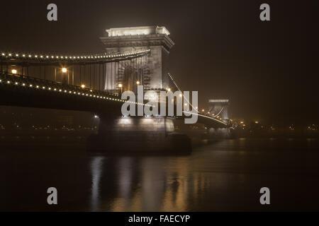 Chain Bridge at night, reflecting in the Danube River, Budapest Hungary - Stock Photo